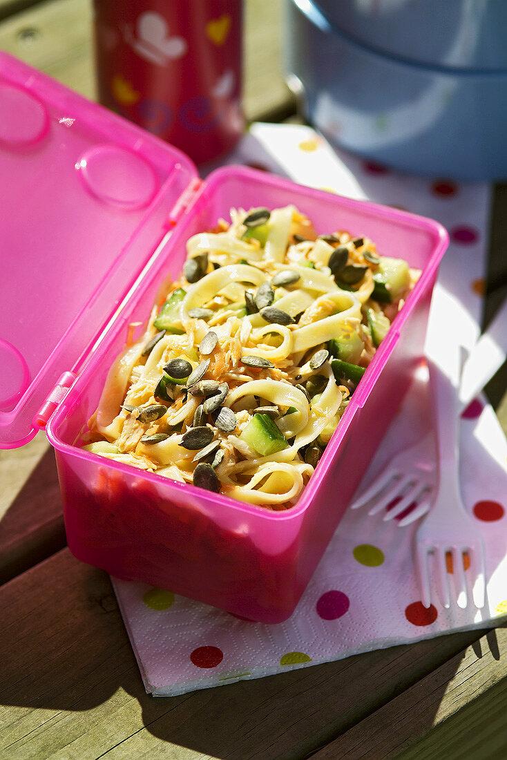 Pasta salad in a plastic box