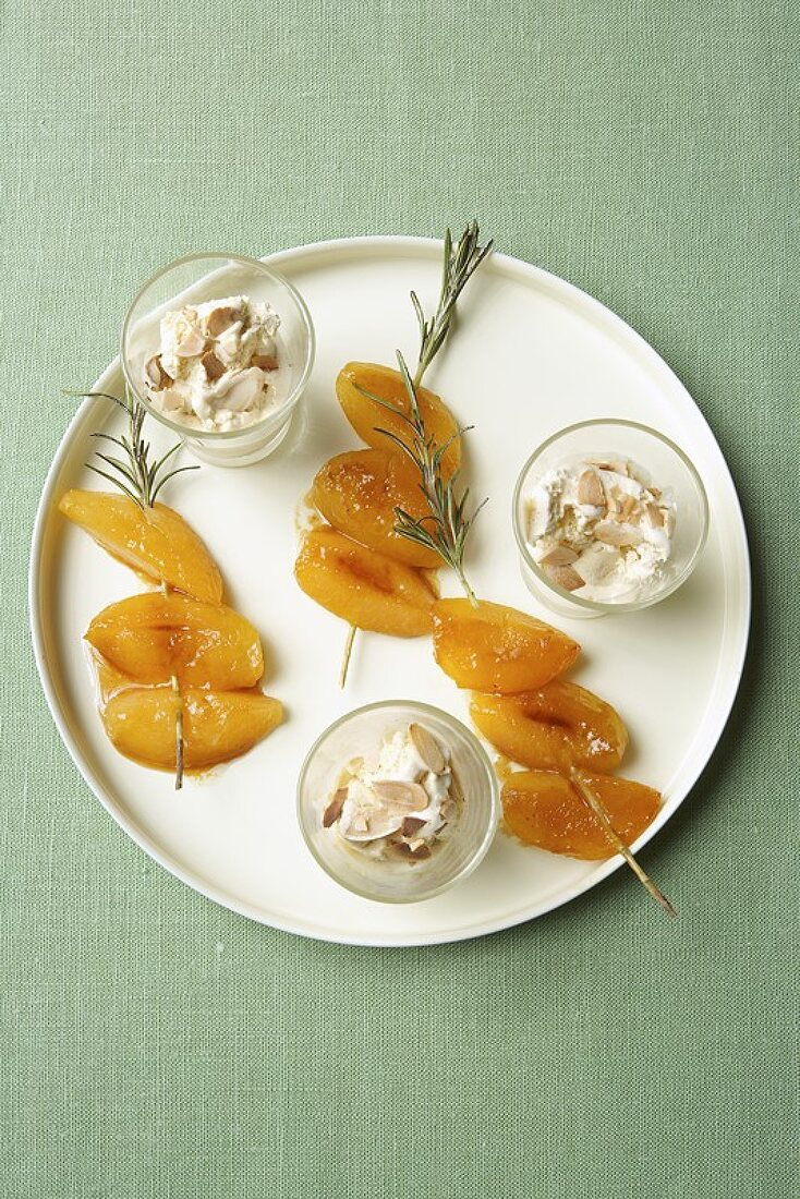 Fried apricots on rosemary skewers with almond parfait