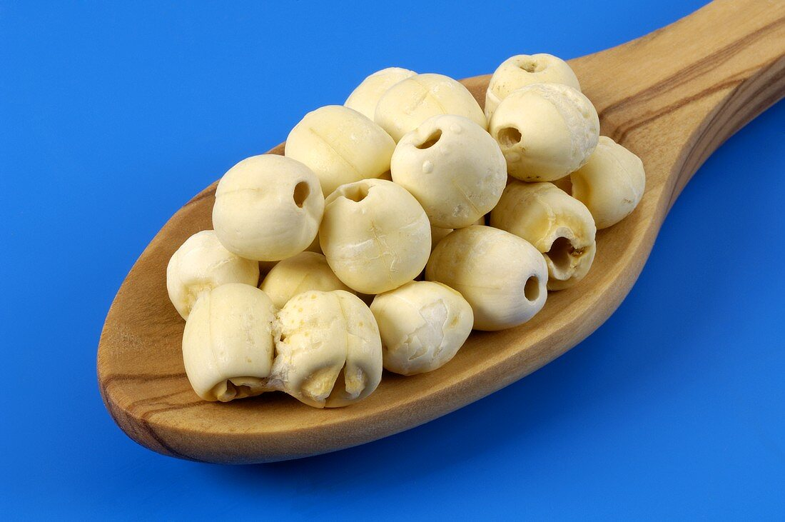 Lotus seeds on a wooden spoon