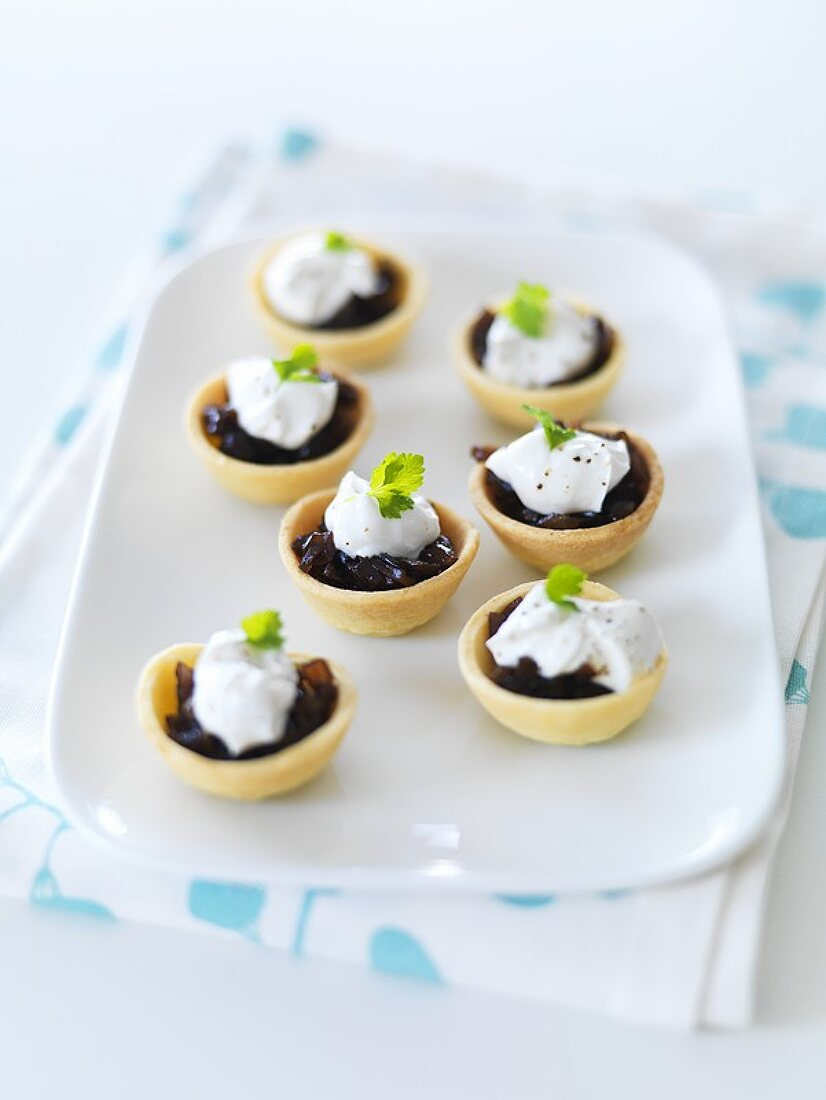 Seven small balsamic onion tarts