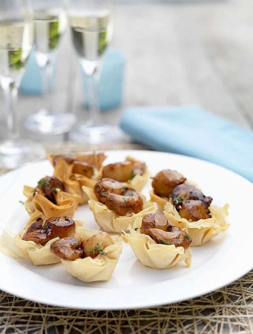 Baked filo pastry baskets filled with scallops