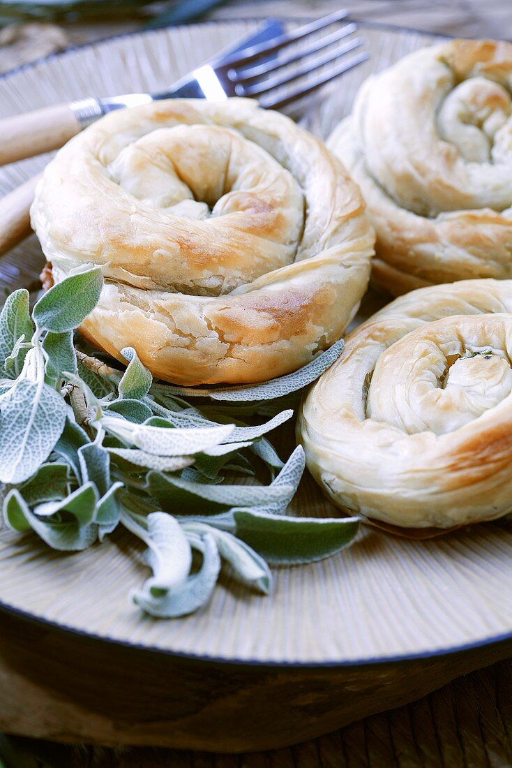 Baked filo pastry coils filled with spinach and feta