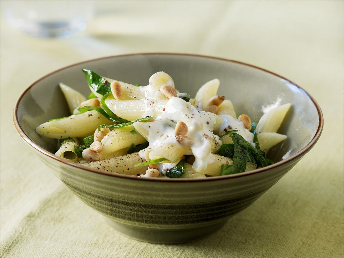 Penne rigate with spinach, pine nuts & fresh goat's cheese