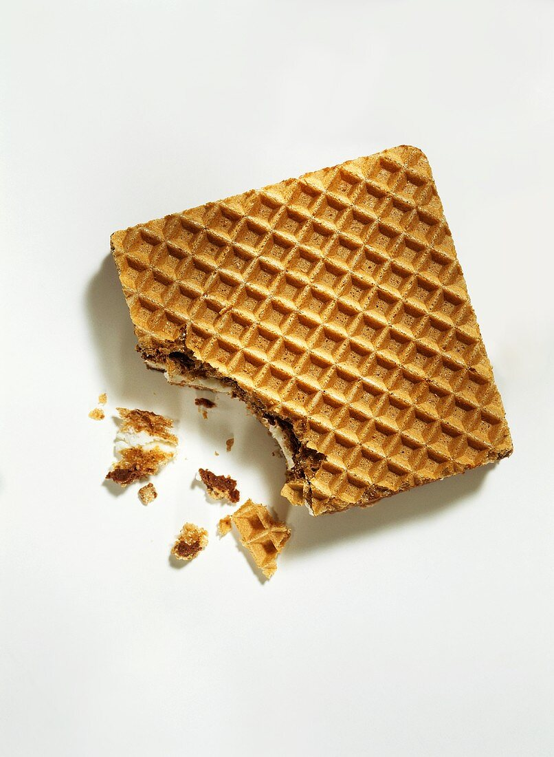 A filled wafer biscuit with a bite taken