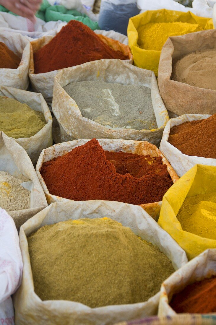 Various spices in sacks at a market in Essaouira