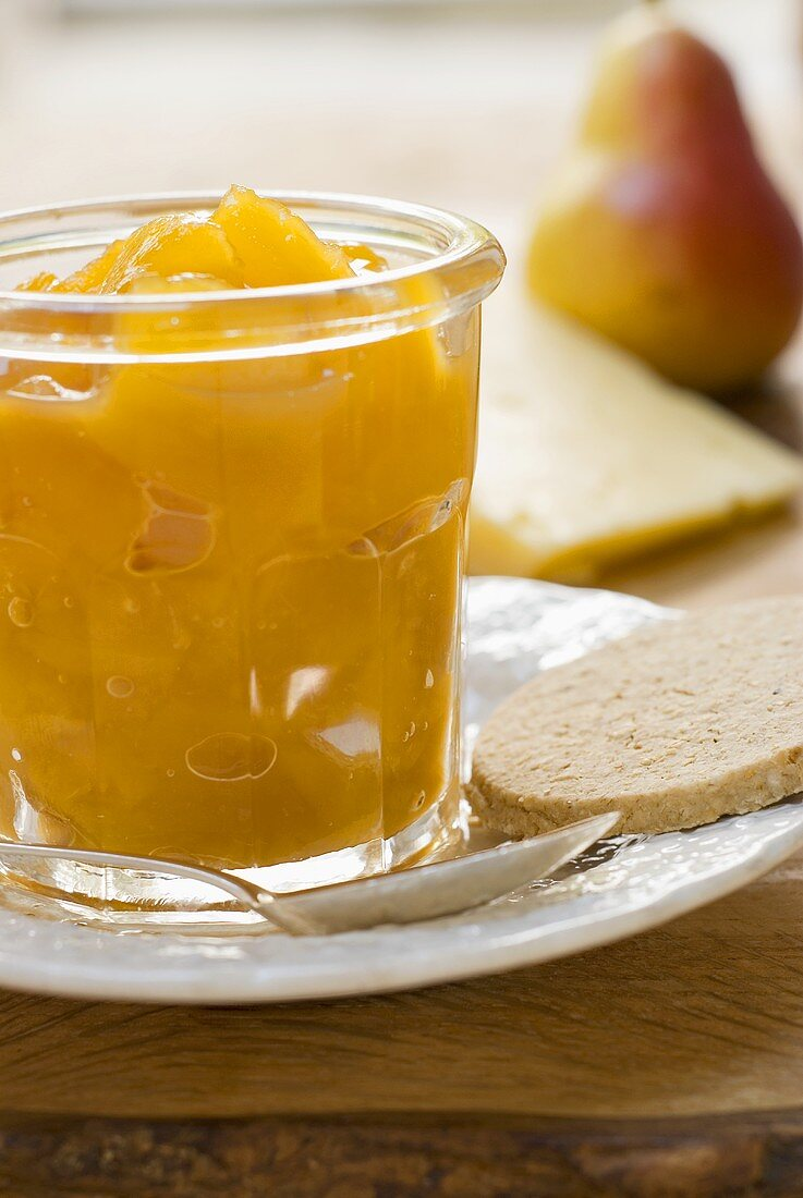 Mango & ginger chutney in a jar with oat biscuit, cheese, pear