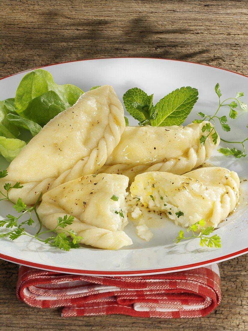 Kärntner Kasnudeln (filled pasta) in butter sauce