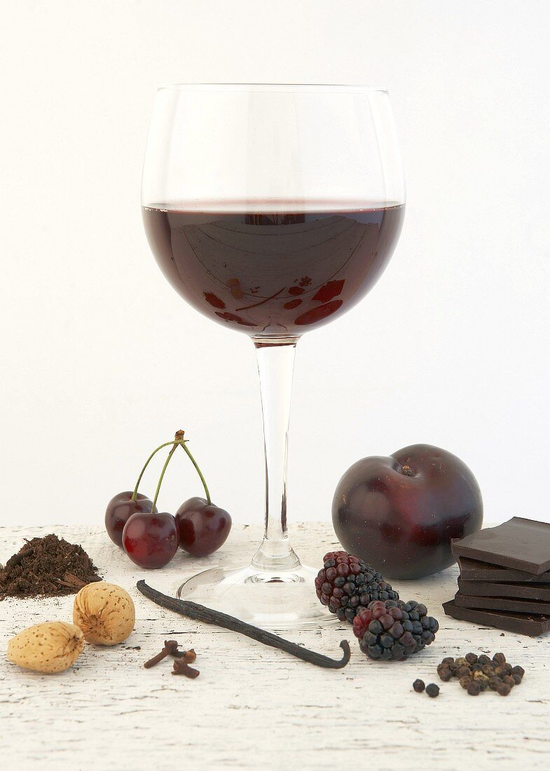 Still life with red wine and components of bouquet
