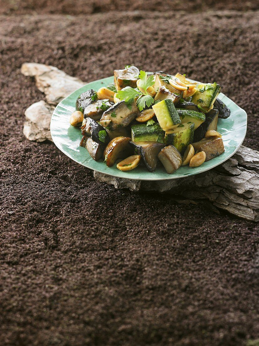 Fried ceps, courgettes and aubergines with peanuts