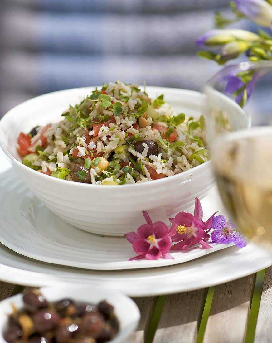 Rice salad with alfalfa sprouts, olives, chick-peas, tomatoes