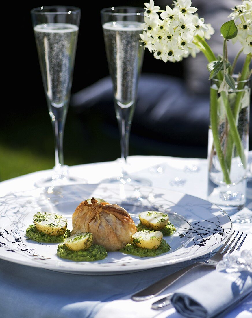 Salmon in filo pastry purse with pea and cress puree