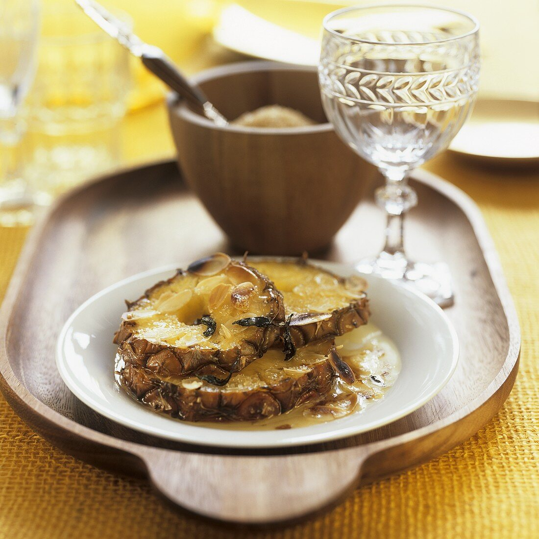 Grilled pineapple slices with honey and almonds