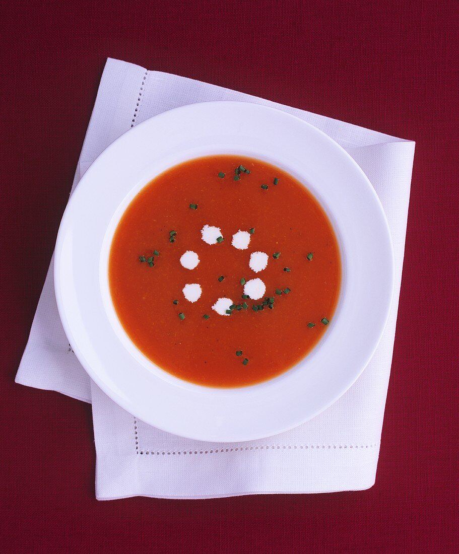 A plate of tomato soup with cream