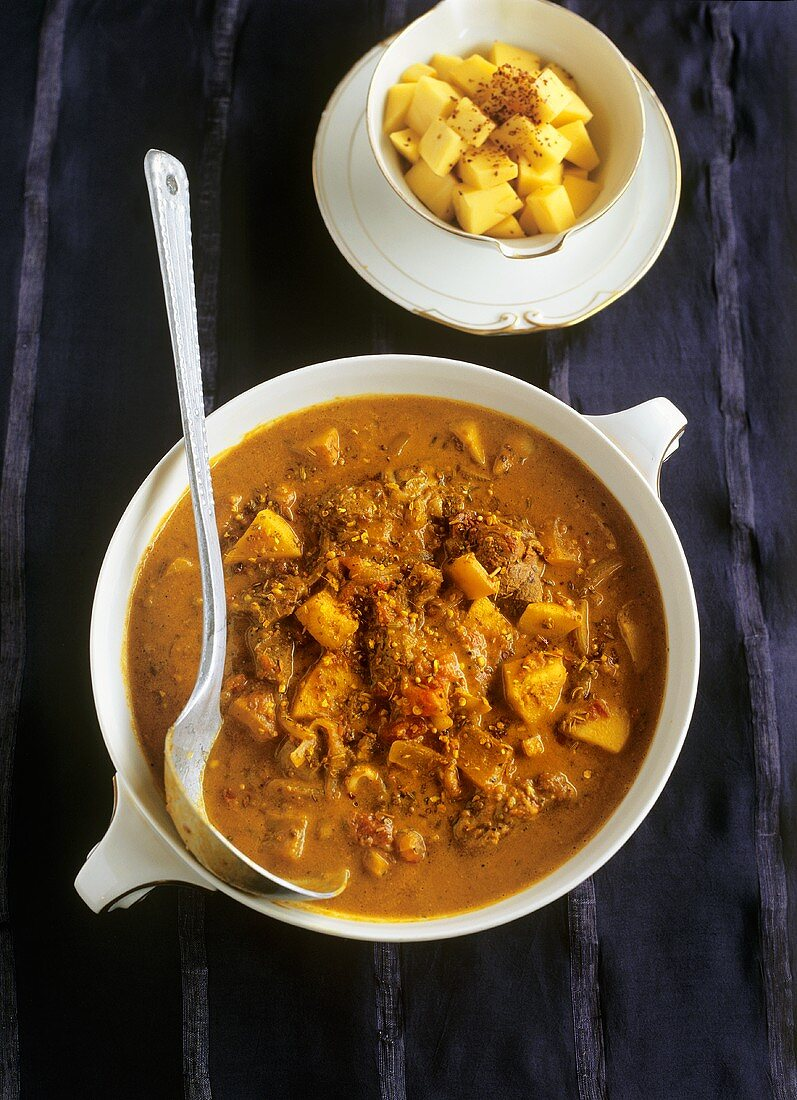 Lamb and coconut curry with mango