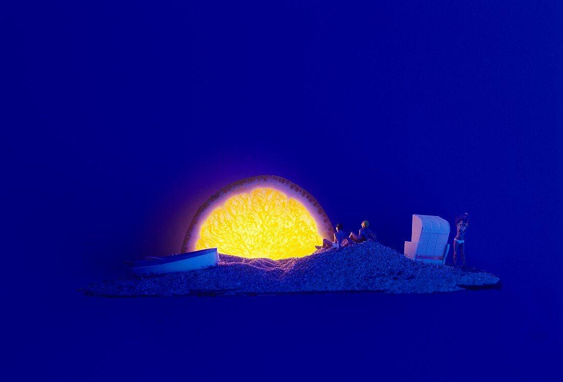 Beach scene with slice of orange as setting sun