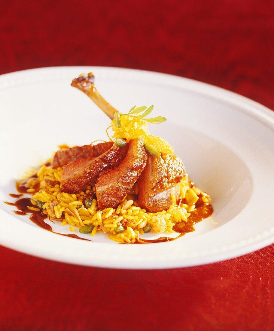 Duck leg with orange on saffron rice
