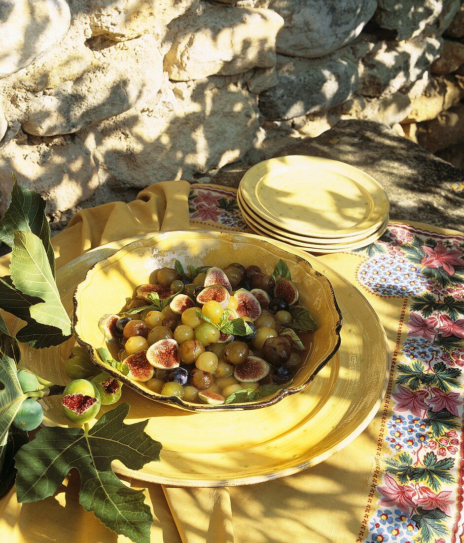 Grape compote with figs and mint out of doors