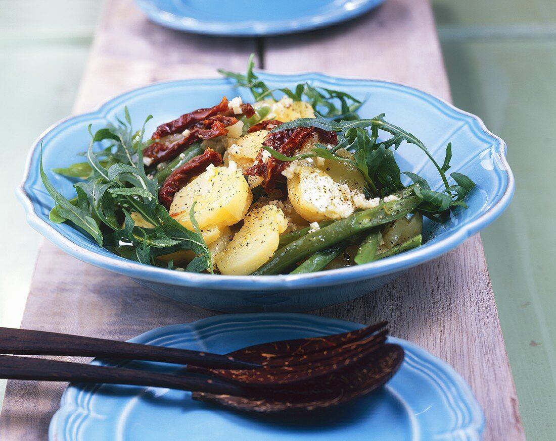 Potato salad with beans, rocket and dried tomatoes