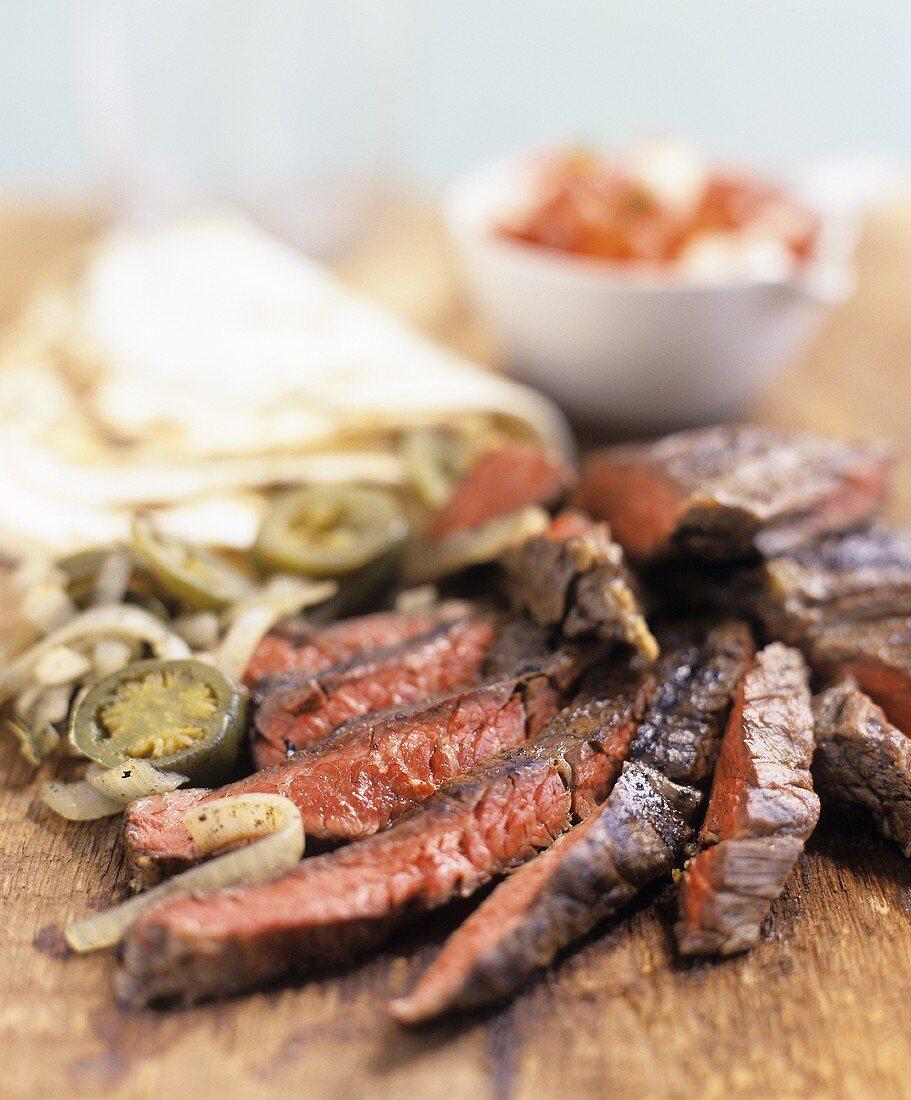 Steak fajitas with jalapeños