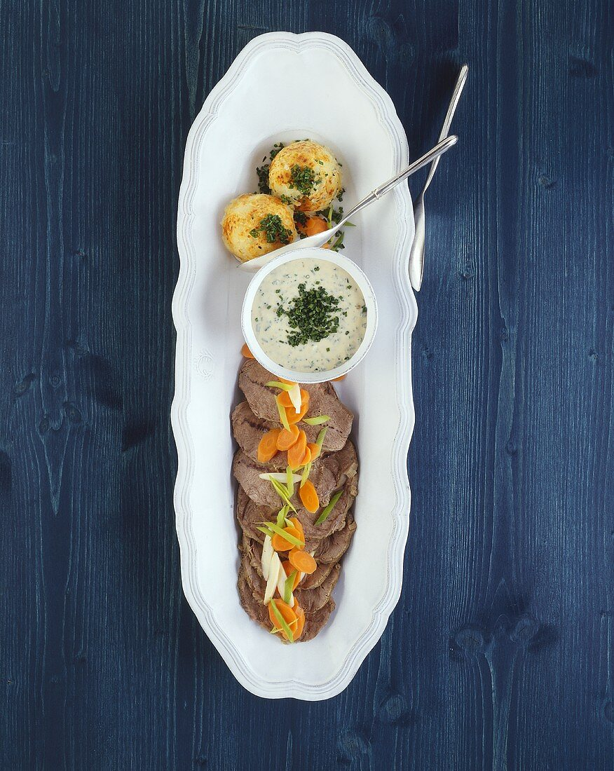 Boiled shoulder of beef with chive sauce
