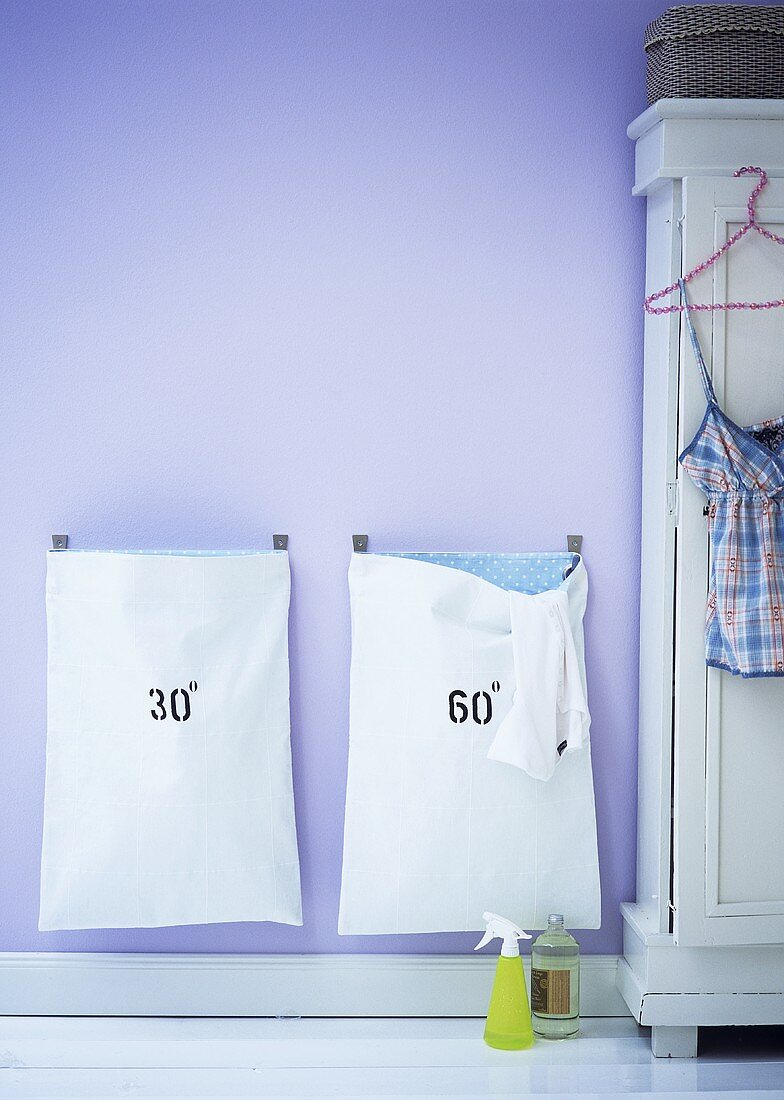 Laundry bags in a bathroom