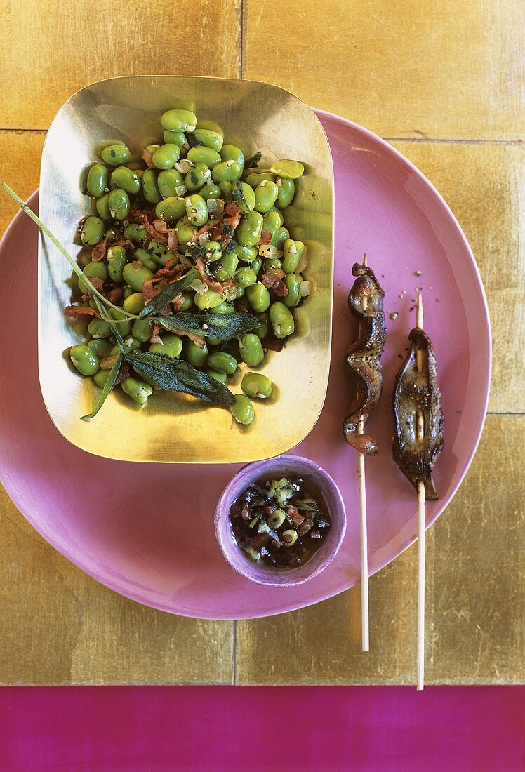 Bean salad with tomato salsa and pig's liver skewers