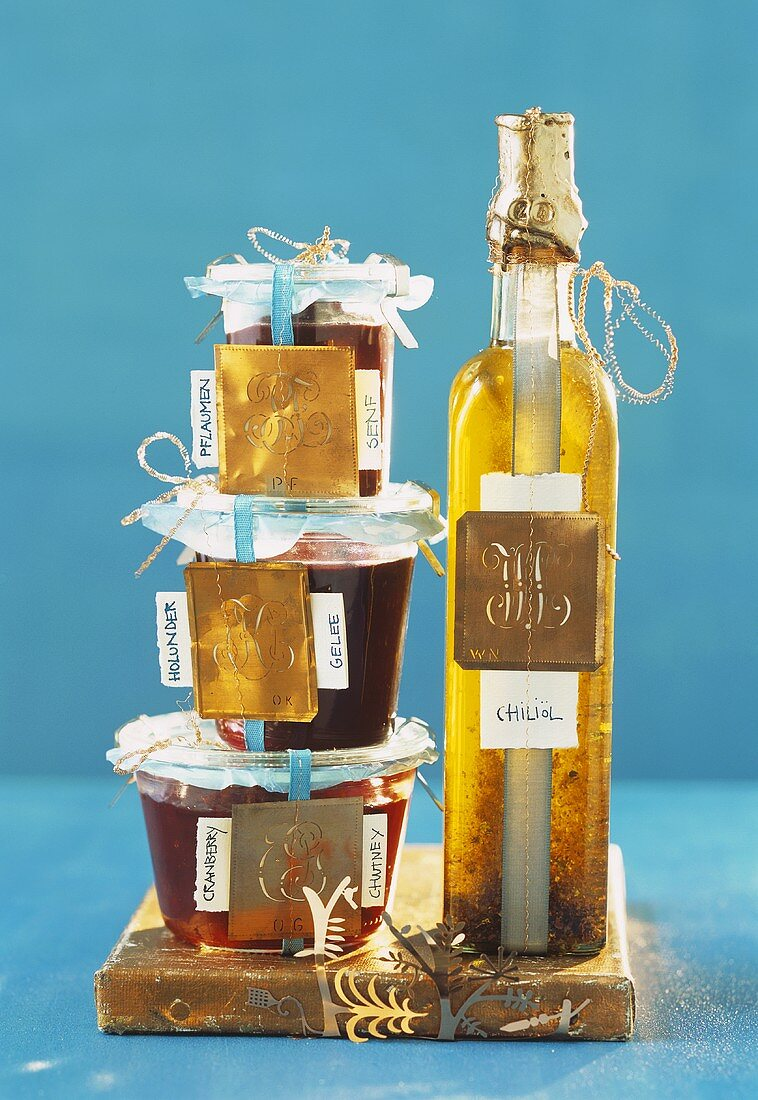 Jars of preserves and bottle of oil to give as gifts