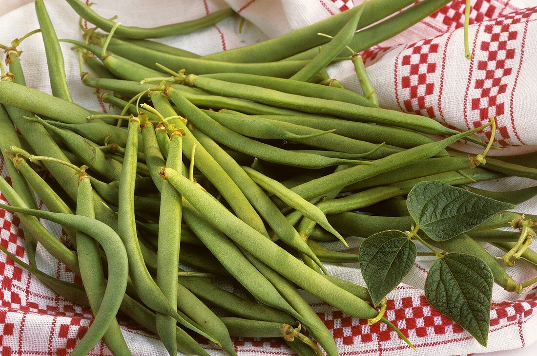 French beans on a tea towel