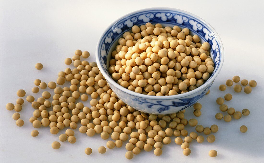Soya beans in and beside a bowl