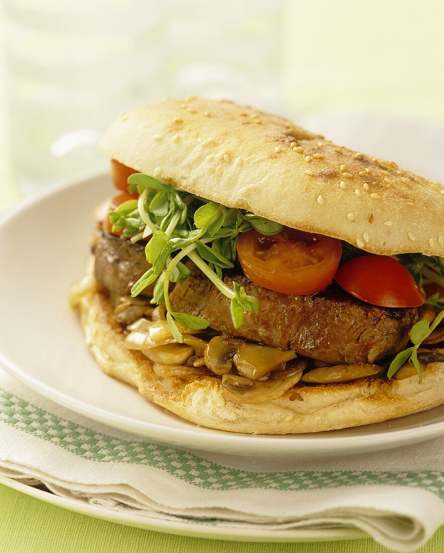 Steak sandwich with tomatoes, mushrooms and pea sprouts
