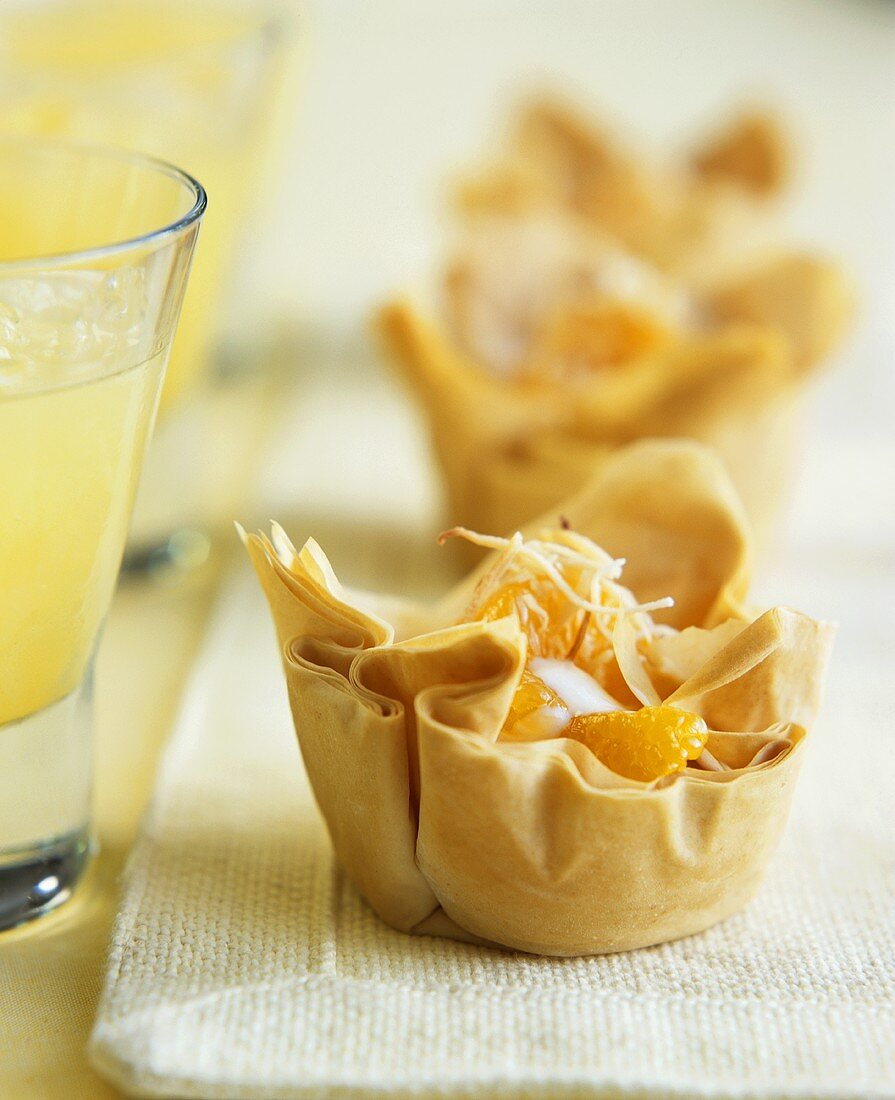 Filo pastry baskets with coconut cream and mandarins