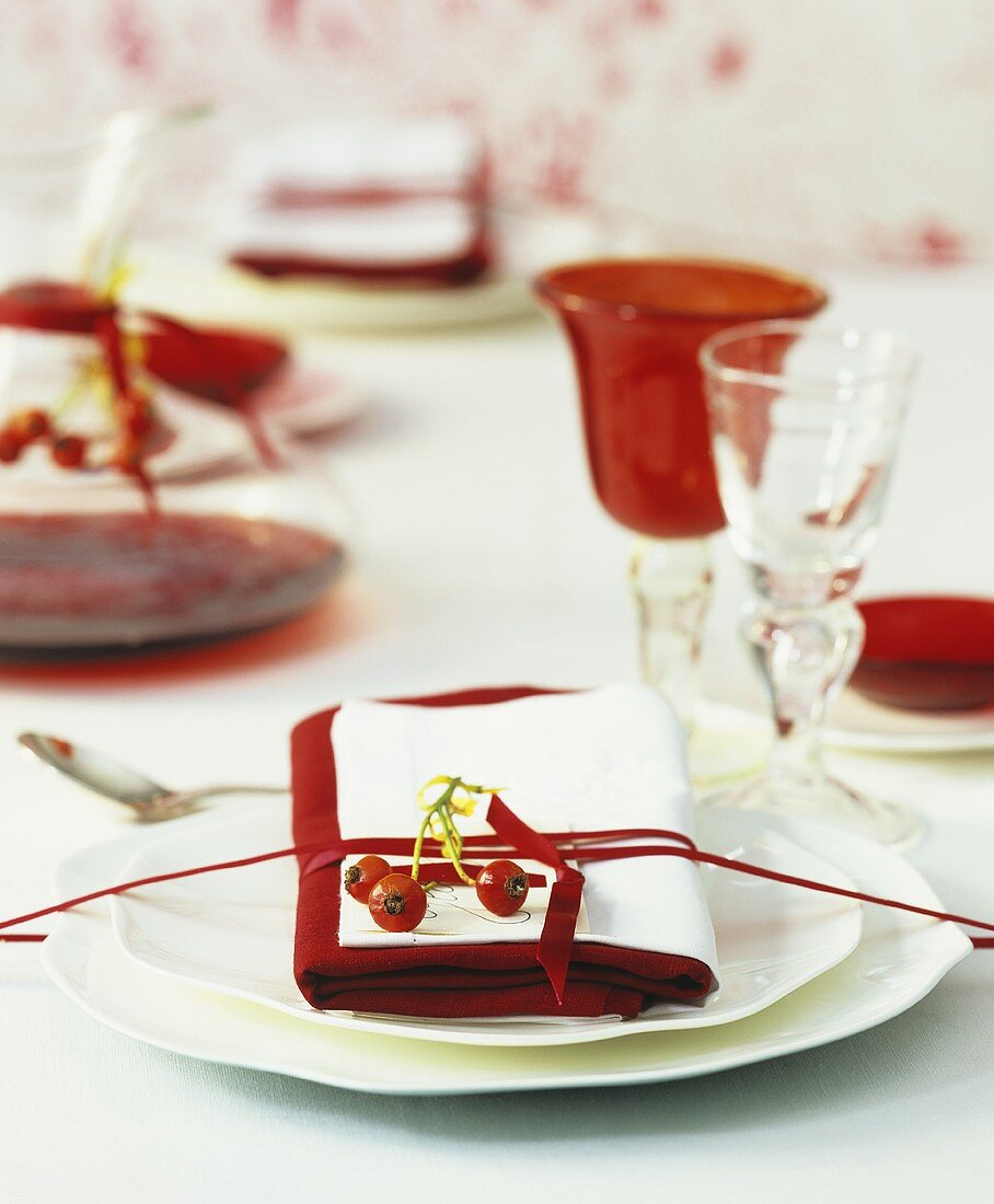 Festively laid Christmas table with red wine