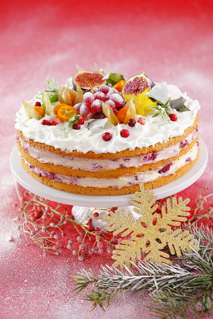 Layer cake with cherry cream, meringue and fruit