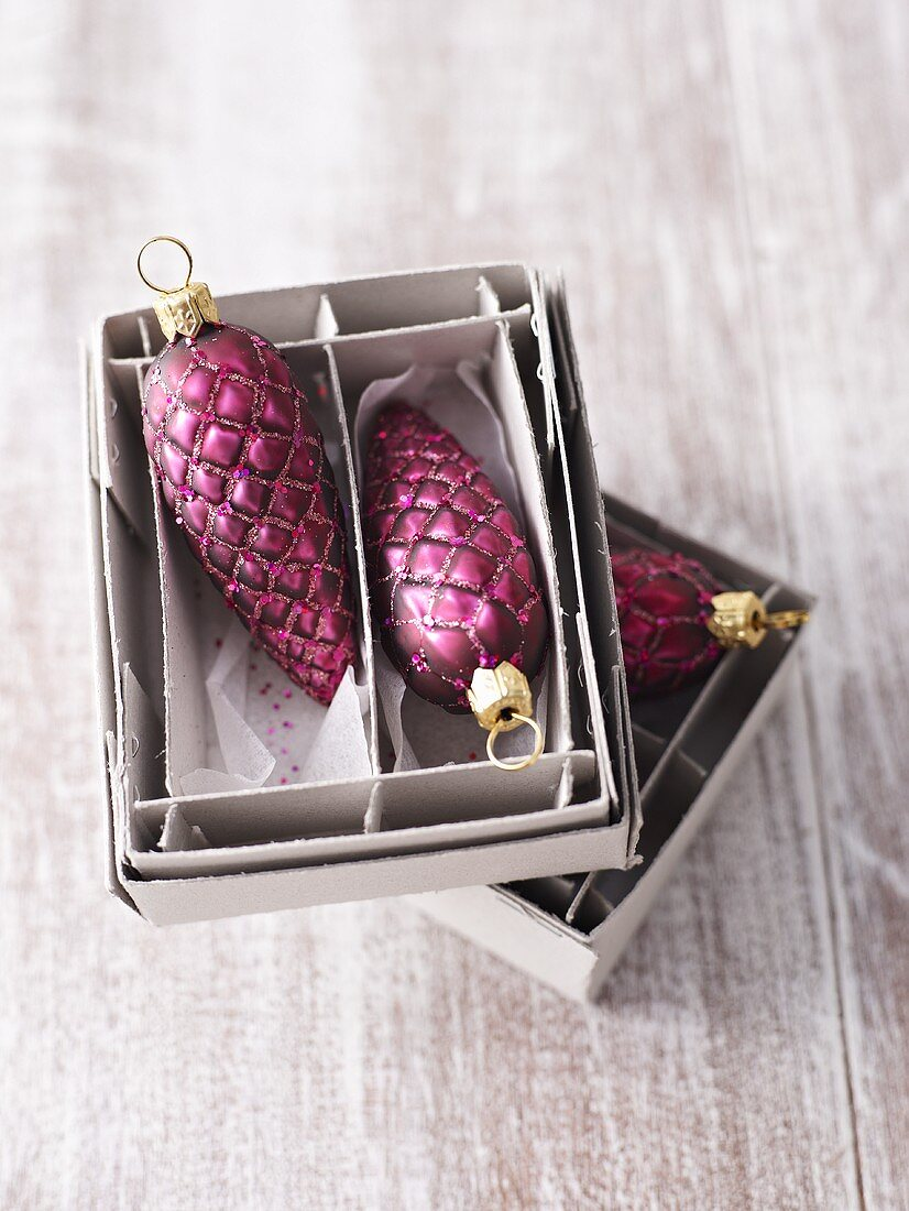 Christmas tree ornaments (fir cones) in boxes