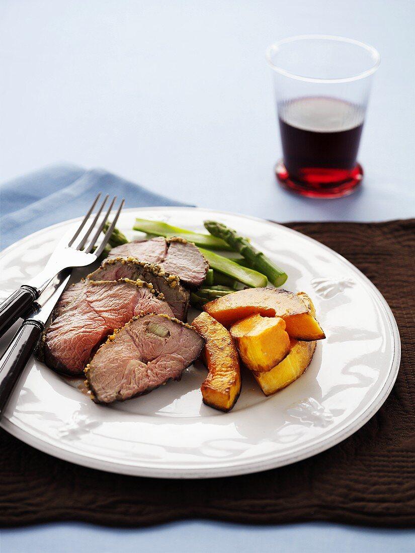 Roast lamb with pumpkin and asparagus