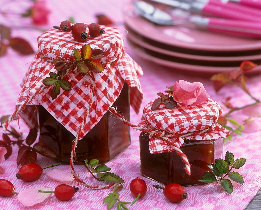 Rose hip jam in jars with checked fabric covers
