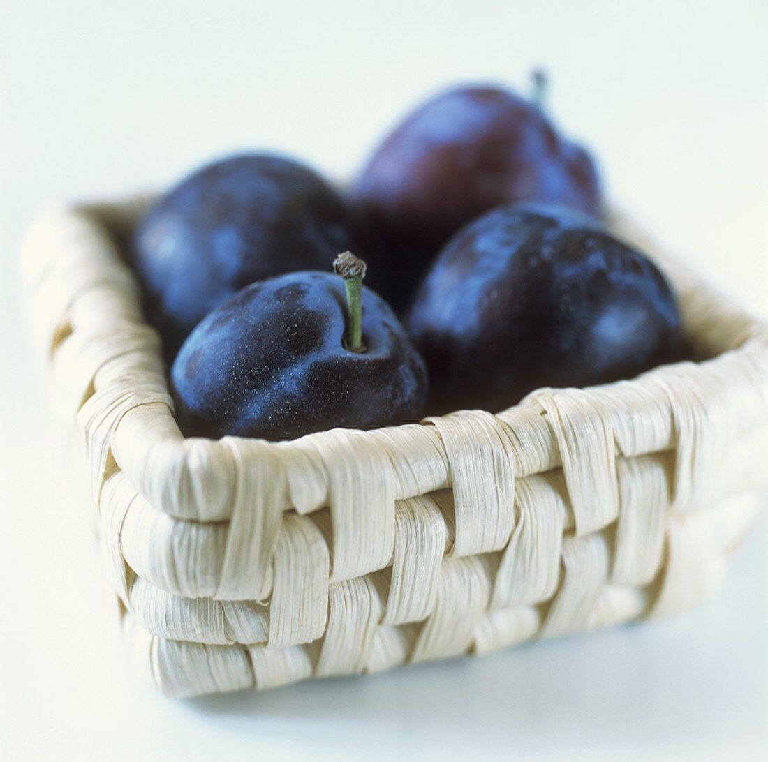 Damsons in a small basket