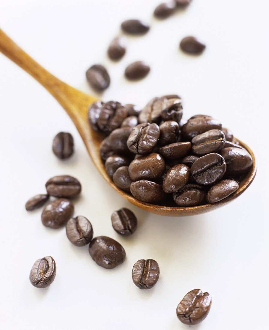 Spoon full of coffee beans