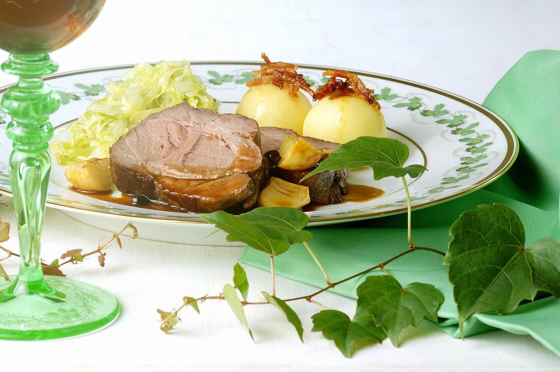 Roast wild boar with white cabbage and potato dumplings