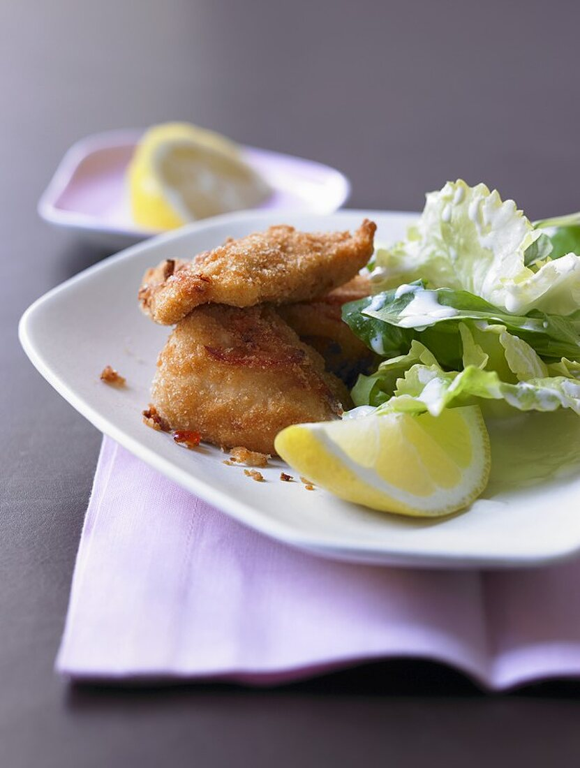 Fried lemon and chilli chicken with endive and corn salad