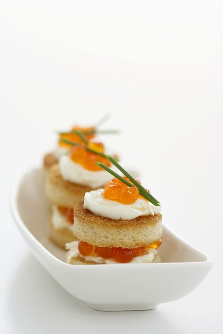 Salmon caviar and sour cream appetisers