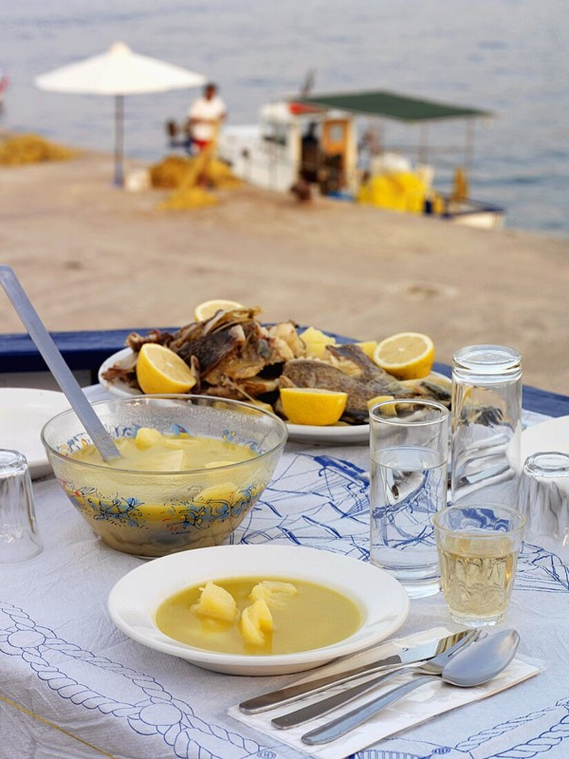 Greek fish soup with the sea in the background