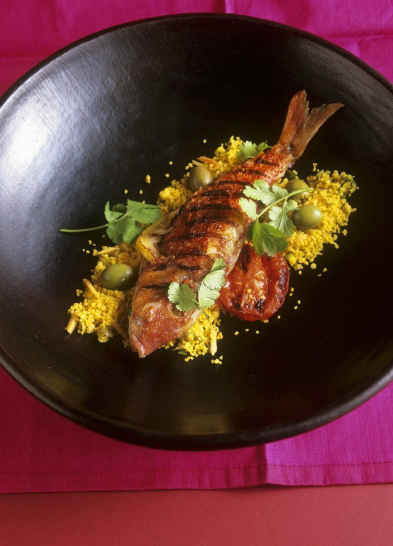 Red mullet with olive & almond couscous (Middle Eastern cuisine)