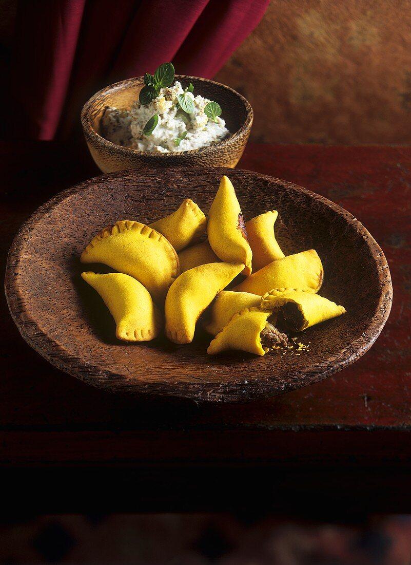 Half-moon-shaped pasties & quark with mint & walnuts (Arab cuisine)