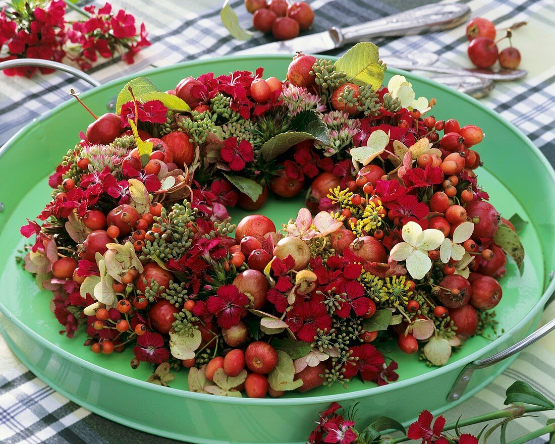 Wreath of hydrangeas, rose hips, fennel and sweet williams