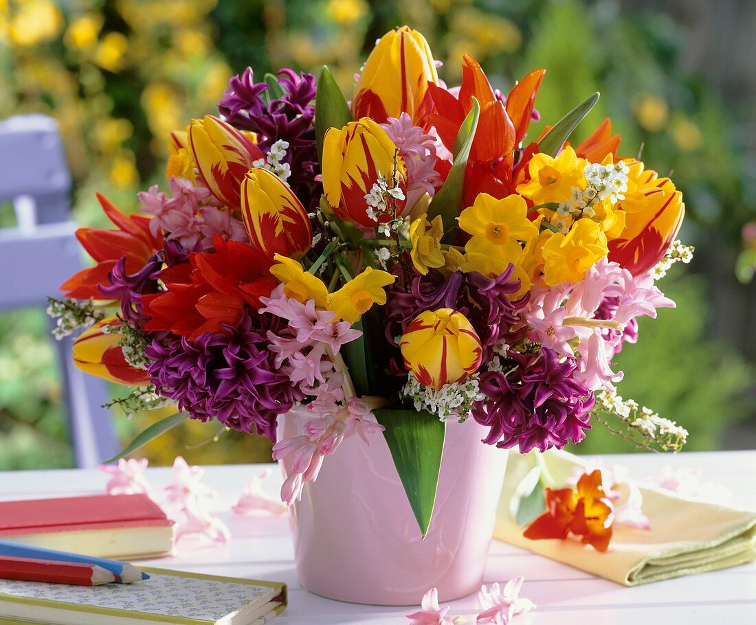 Vases of tulips, hyacinths, narcissi and spiraea