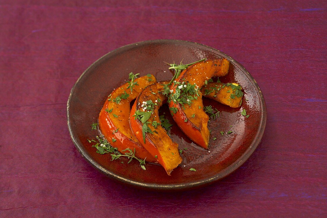 Roasted pumpkin wedges with herbs