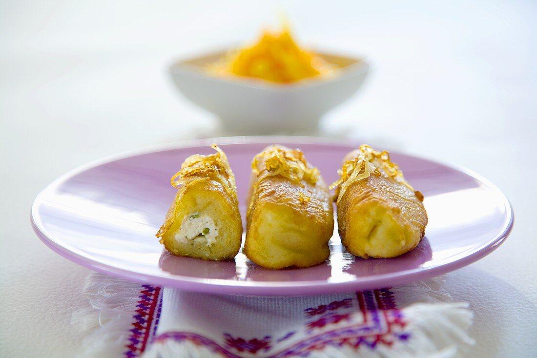Deep-fried potato dumplings with quark stuffing (Ukraine)