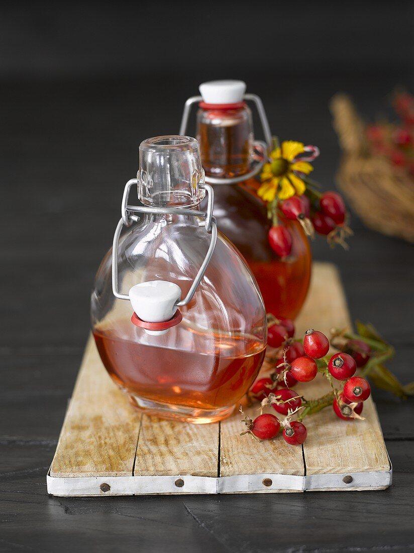 Rose hip liqueur in two bottles