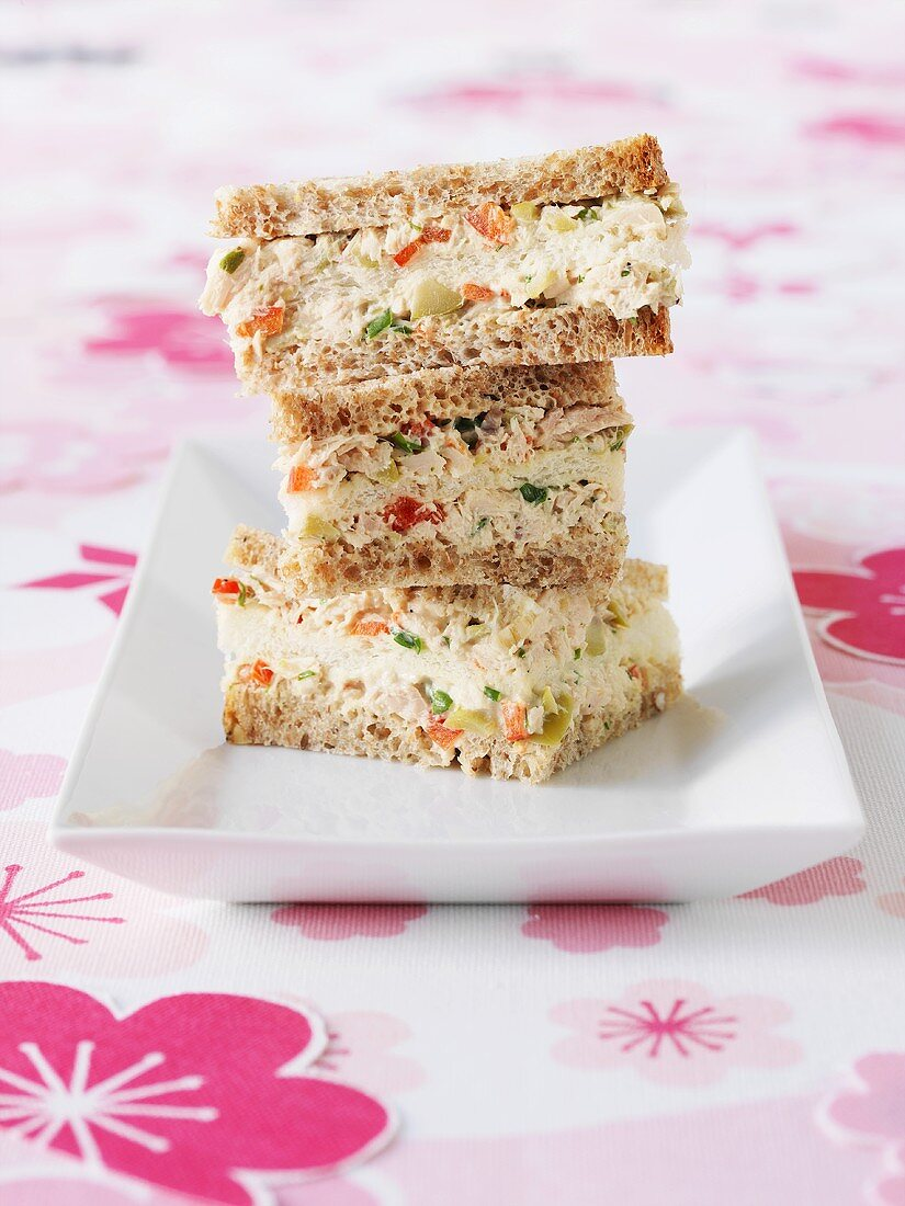 Sandwiches filled with tuna, olive and tarragon spread